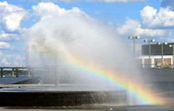 Fountain with rainbow near the river Dnieper, Dnepropetrovsk, Ukraine. Fountain with rainbow near the river Dnieper against the backdrop of beautiful clouds royalty free stock photography