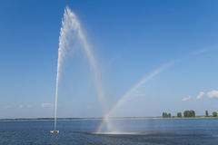 Fountain and rainbow Stock Images