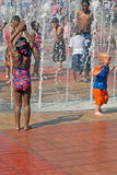 Fountain of Rings Centennial Olympic Park Atlanta. Children cooling off on a hot day in the dancing water on the red brick of the Fountain of Rings at Centennial Royalty Free Stock Photos
