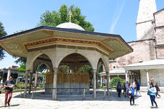 Fountain for ritual ablutions of Hagia Sophia, Istambul, Turkey. ISTANBUL - MAY 20, 2016: Tourists visiting the Fountain (Şadırvan) for ritual ablutions in royalty free stock photo