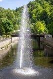 Fountain in river Tepla in Karlovy Vary Stock Photo