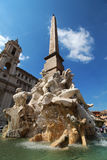 Fountain in Rome. Image taken in Piazza Navona, Rome. Typical italian arhitecture in the background. Elaborate fountain in foreground. Nice balance of colours Royalty Free Stock Photography
