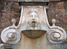 Fountain in Rome, Italy. Fountain of the Mask in via Giulia, Rome, Italy Stock Photography