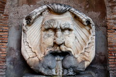 Fountain in Rome. Monster face of fountain near park Savello on Aventino hill in Rome, Italy Stock Image