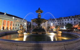 Fountain at Rossio square, Lisbon. Fountain at Rossio square in the evening, Lisbon Stock Photos