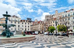 Fountain on Rossio Square in Lisbon, Portugal. Rossio square with fountain located at Baixa district in Lisbon, Portugal Royalty Free Stock Photo