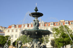 Fountain in Rossio Square Stock Images