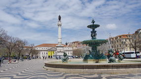 Fountain on the Rossio square. View to the Pedro IV square, Lisbon royalty free stock images