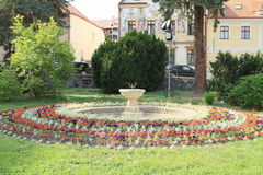 Fountain in round garden Stock Photos