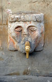 Fountain rustic of stone heads, Grazalema, Cadiz province, Spain Royalty Free Stock Photography