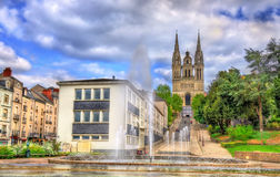 Fountain and Saint Maurice Cathedral of Angers in France Stock Photography