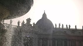 Fountain and Saint Peter Basilica. Ancient cathedral on sky background stock video footage