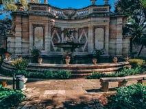 San Anton garden in Malta. Fountain in San Anton garden. Red stones, ancient fountain tells a history Royalty Free Stock Photography