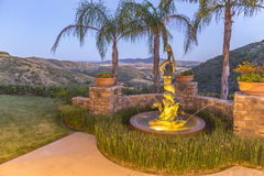 Fountain in San Diego backyard with an amazing view. Outdoors in Southern California homes ready for real estate listings Royalty Free Stock Image