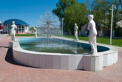 Fountain with sculptures in the Volzhsk town. Fountain with sculpture of an angel in the center of the Volzhsk town Stock Images
