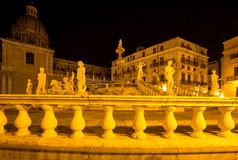 Fountain of shame on  Piazza Pretoria at night, Palermo, Italy. Famous fountain of shame on baroque Piazza Pretoria at night, Palermo, Italy Royalty Free Stock Images