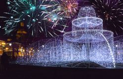 Fountain from the shining fires on the square in front of St. Isaac Cathedral on New Year`s Eve and Christmas fireworks. St. Pete stock photos