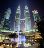 Fountain show at night in front of Petronas Twin Towers Royalty Free Stock Photography
