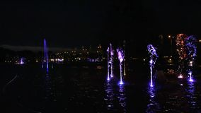 Fountain show at night in Multimedia Fountain Park stock footage