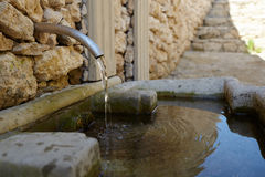 Fountain. Small rural fountain in village, clear water Royalty Free Stock Photo