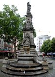 Fountain in a small square in Cologne, Germany Royalty Free Stock Photos
