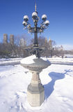 Fountain with snow in Central Park, Manhattan, New York City, NY after winter snowstorm Stock Photo