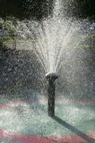 Fountain Spraying Water Backlit by Sun Stock Photos