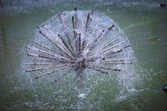 Fountain sprinkler hemisphere. Fountain sprinkler in the form of hemisphere in the pool, Donetsk municipal park zone stock photos