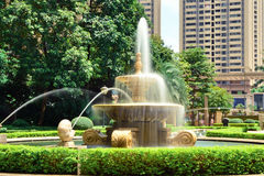 Fountain is sprinkling in the park Stock Photography