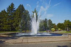 Fountain spurt of water. Fountain into the square spurt of water royalty free stock image