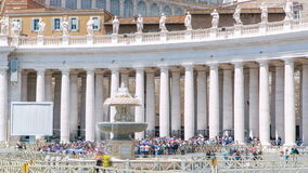 Fountain on St. Peter's square timelapse in Vatican City. Piazza San Pietro and Basilica. With tourists at summer day stock video