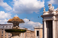 Fountain at St Peter square with pigeons in Vaticano Royalty Free Stock Image