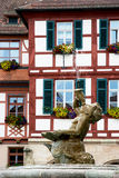 Fountain statue boy and bavarian house in Schwabach Stock Images
