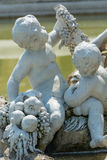 Fountain statue of two baby boys in front of Schönbrunn palace Vienna Royalty Free Stock Photography