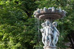 Fountain with statues of children Stock Photo