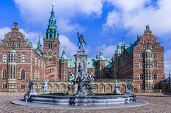 Fountain with statues in front of Frederiksborg Palace, Denmark. Fountain with stone statues placed in front of the Renaissance Frederiksborg Palace built by stock image