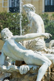 Fountain statues in front of Schönbrunn palace Vienna Stock Photo