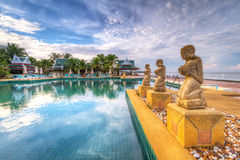 Fountain statues at  swimming pool in Thailand. Fountain statues in the tropical scenery of Thailand Royalty Free Stock Images