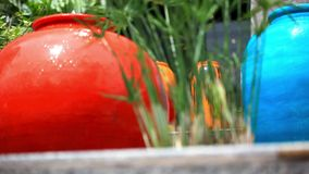 Fountain in Stone colorful jars. HD. 1920x1080 stock video footage