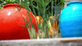 Fountain in Stone colorful jars. HD. 1920x1080 stock video