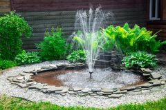 Fountain, stone and green grass Stock Photo