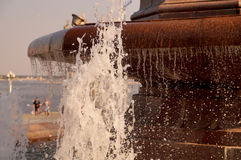Fountain stream on the Volgograd embankment Stock Photos