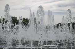 Fountain streams and splashes cloudy summer in the Park close-up stock photo