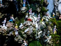 Amusing fountain with tiny figures in Amalfi Italy depicting life in the mountains behind the city Stock Image