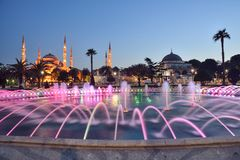 Fountain and The Sultan Ahmed Mosque. In Istanbul during sunset royalty free stock images