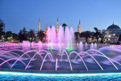 Fountain and The Sultan Ahmed Mosque. In Istanbul during sunset royalty free stock photo