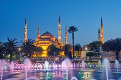 Fountain and The Sultan Ahmed Mosque. In Istanbul during sunset stock photography