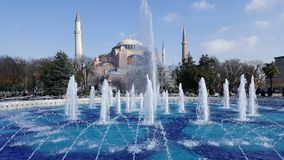 Fountain and Sultan Hamet Mosque or Blue Mosque in Istanbul, Turkey.  royalty free stock photography