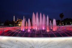Fountain and the Sultanahmet Blue Mosque at night Stock Photography
