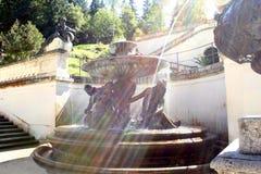 Fountain in sunrays Stock Photography